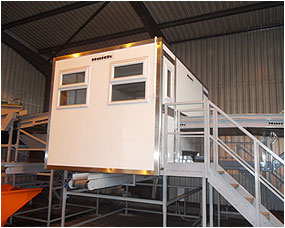 Insulated cabin for picking station - shown here with feed conveyor input as part of a line